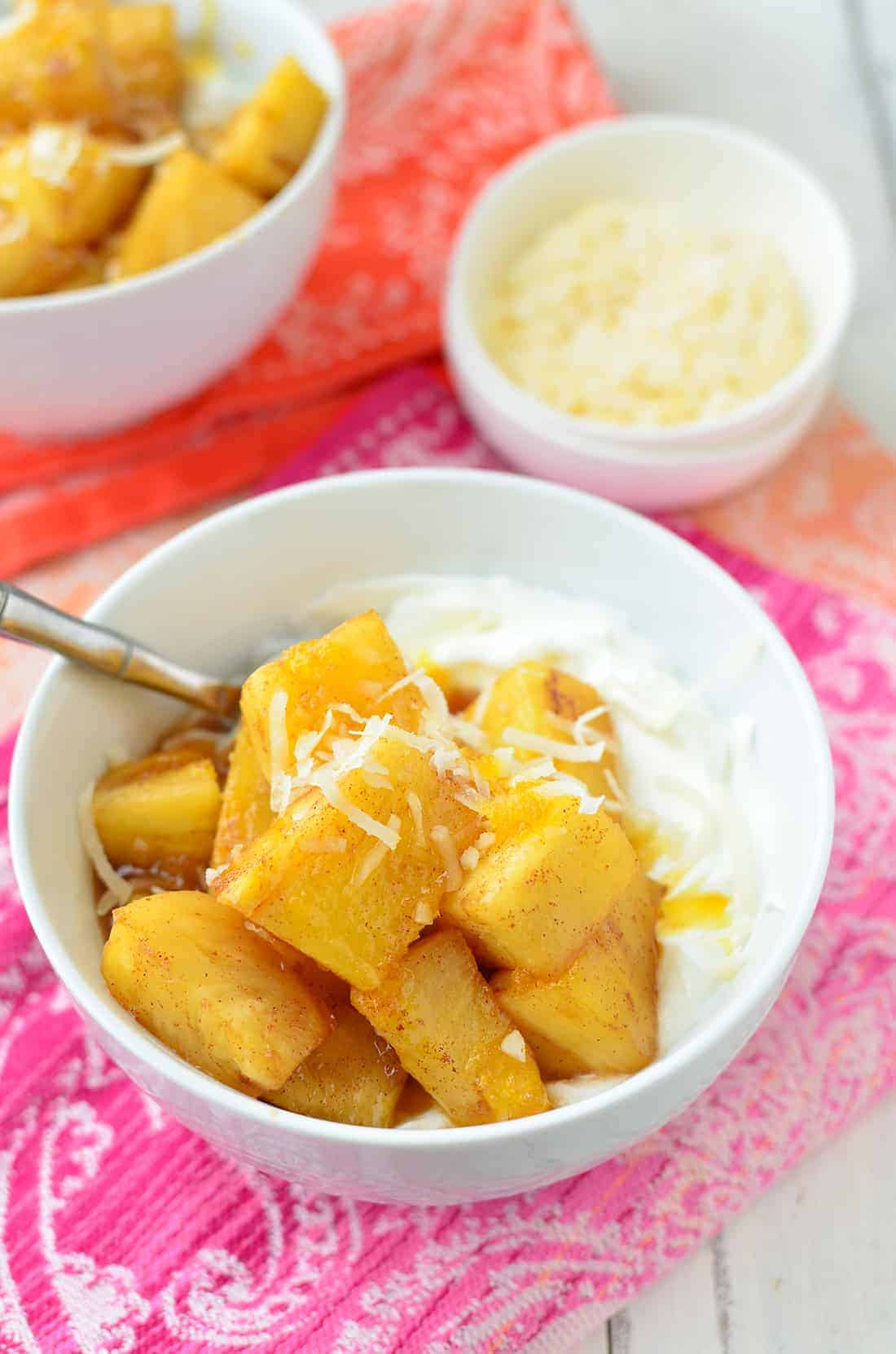 Caramelized Pineapple Yogurt Bowls! You've gotta try these, so simple just 6 ingredients. Caramelized Coconut Pineapple over creamy yogurt. #vegetarian #healthy | www.delishknowledge.com