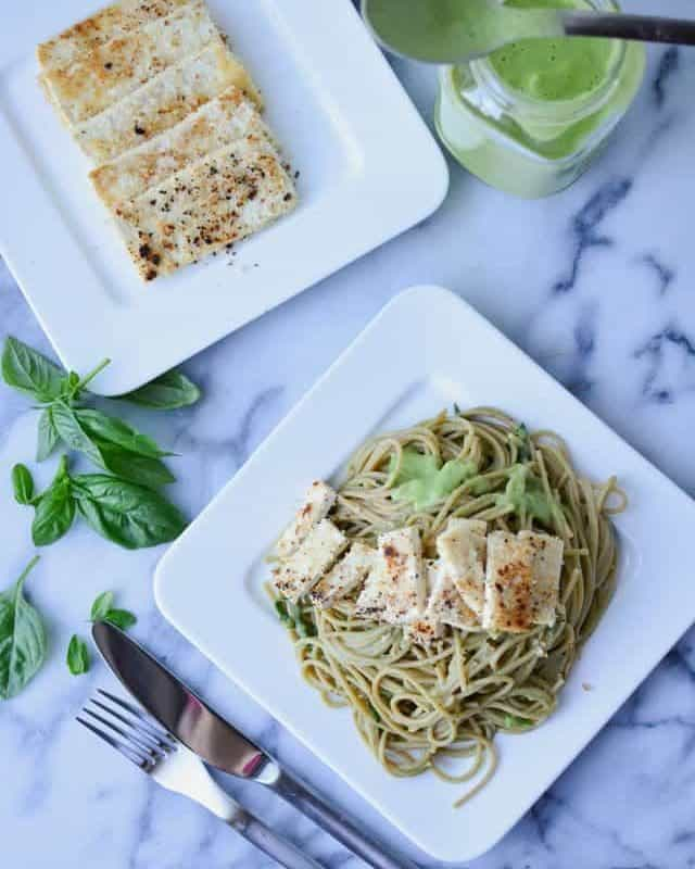 Creamy dairy-free sauce- using Cauliflower! Taste just like traditional white sauces- with 1/4 of the fat and calories. Cauliflower Pesto Sauce with Crispy Tofu.