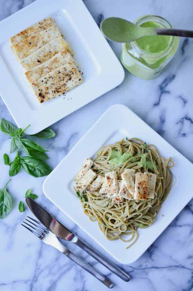 Cauliflower Pesto Pasta! Creamy, dairy-free pesto-cauliflower sauce with seared tofu and whole-wheat pasta