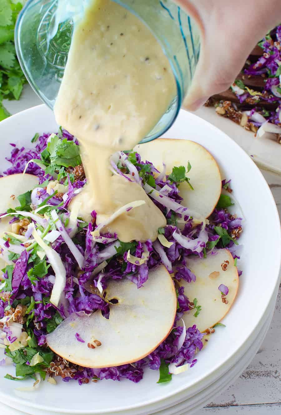 Winter Slaw! So, so good! Cabbage, Endive, Apples, Parsley, Walnut and Quinoa is a lemony-tahini sauce. Such a healthy side dish or main | www.delishknowledge.com