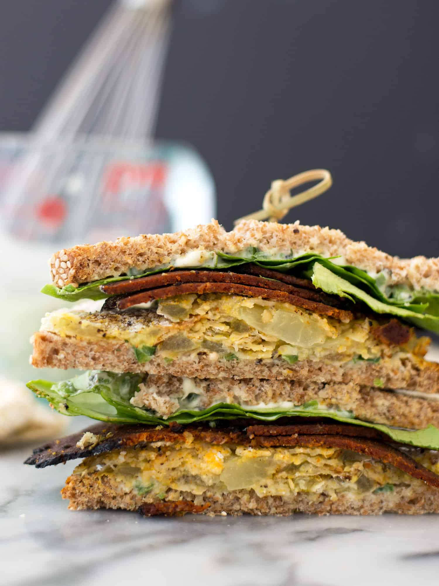 Fried Green Tomato Vegan BLTs! Crispy, faux-fried green tomatoes with vegan bacon and jalapeno-lime spread. | www.delishknowledge.com