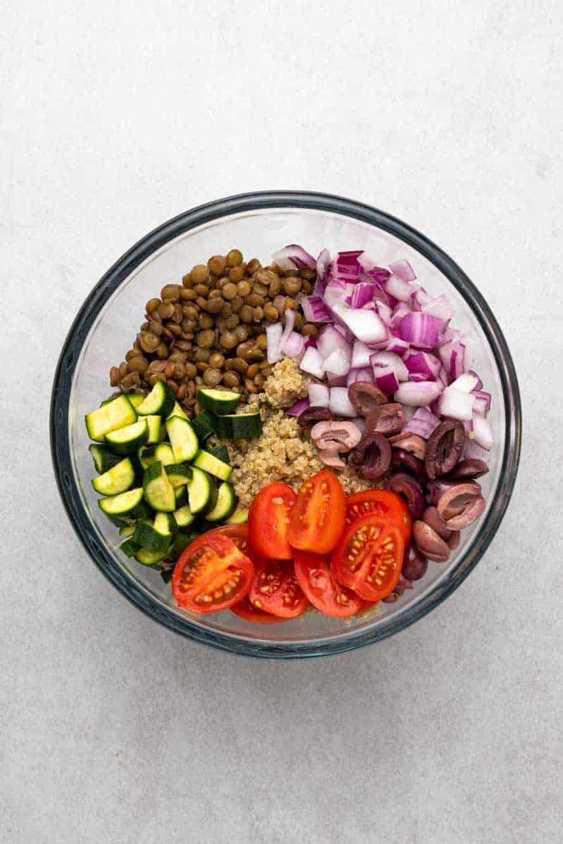 greek lentil salad ingredients in bowl
