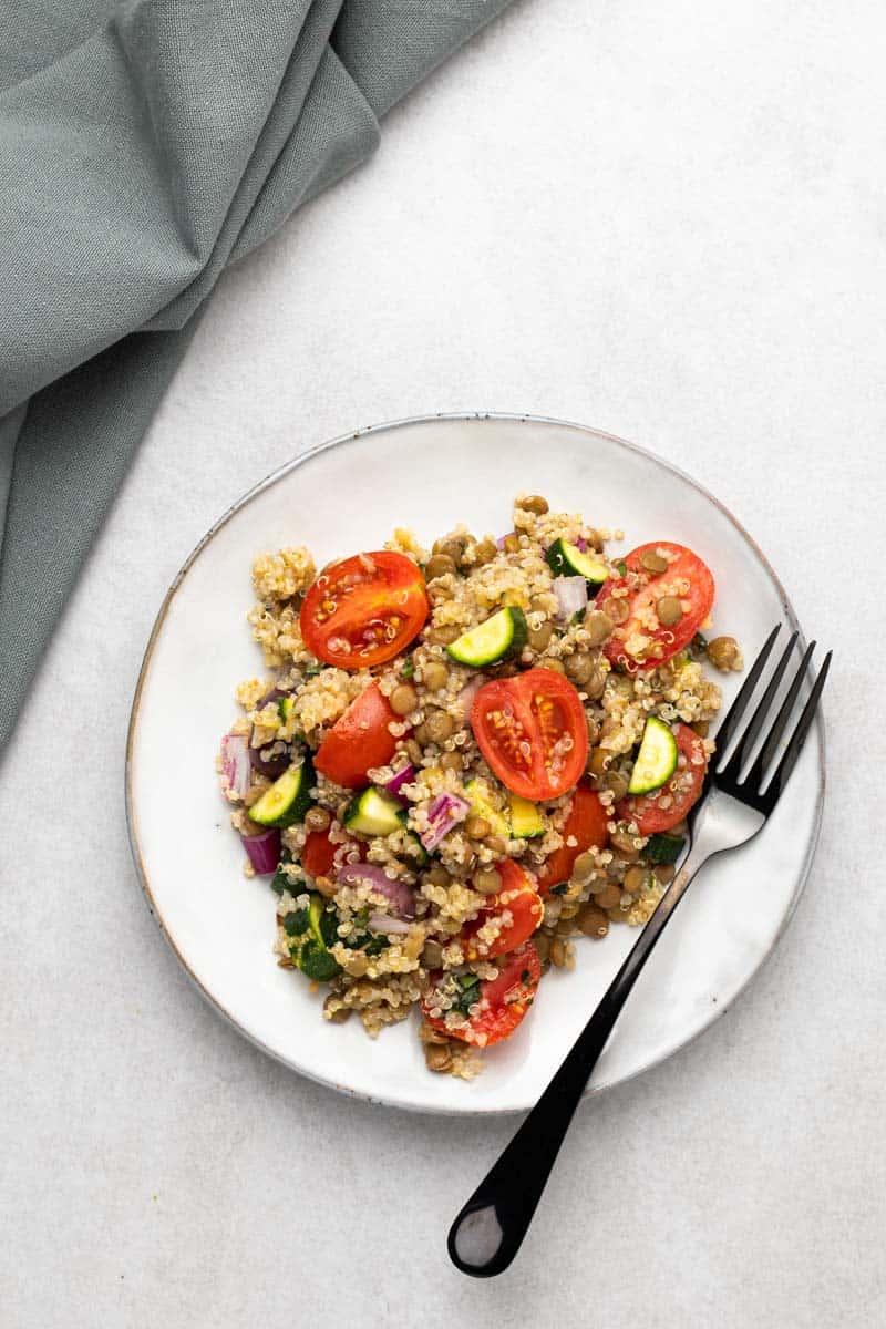 greek lentil salad in plate with fork