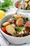 Greek Lentil and Potato Salad! This side salad is perfect for summer. Lentils, herbed potatoes and vegetables in a lemon dressing. A must-try! Vegetarian, easily vegan. | www.delishknowledge.com