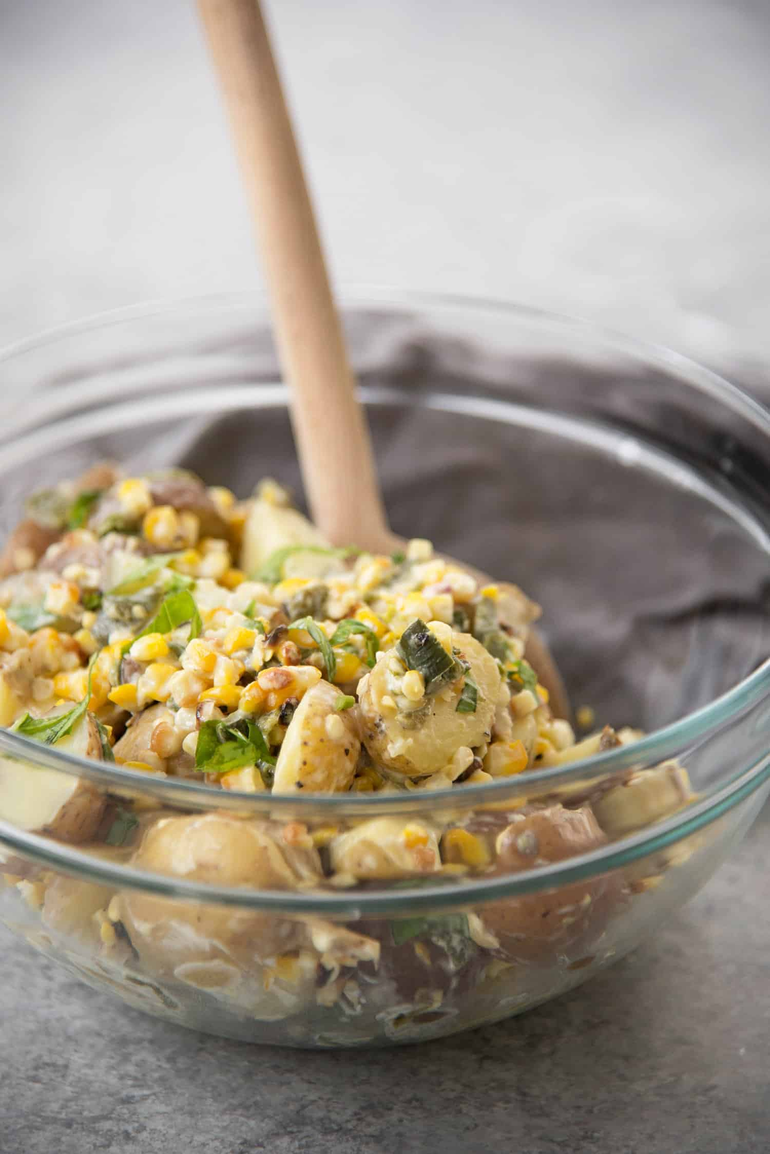 Grilled Corn, Poblano and Potato Salad! A must-make for summer BBQs and potlucks. Grilled corn, potato and poblano peppers mixed with a dairy-free basil dressing. Vegan and Gluten-Free | www.delishknowledge.com