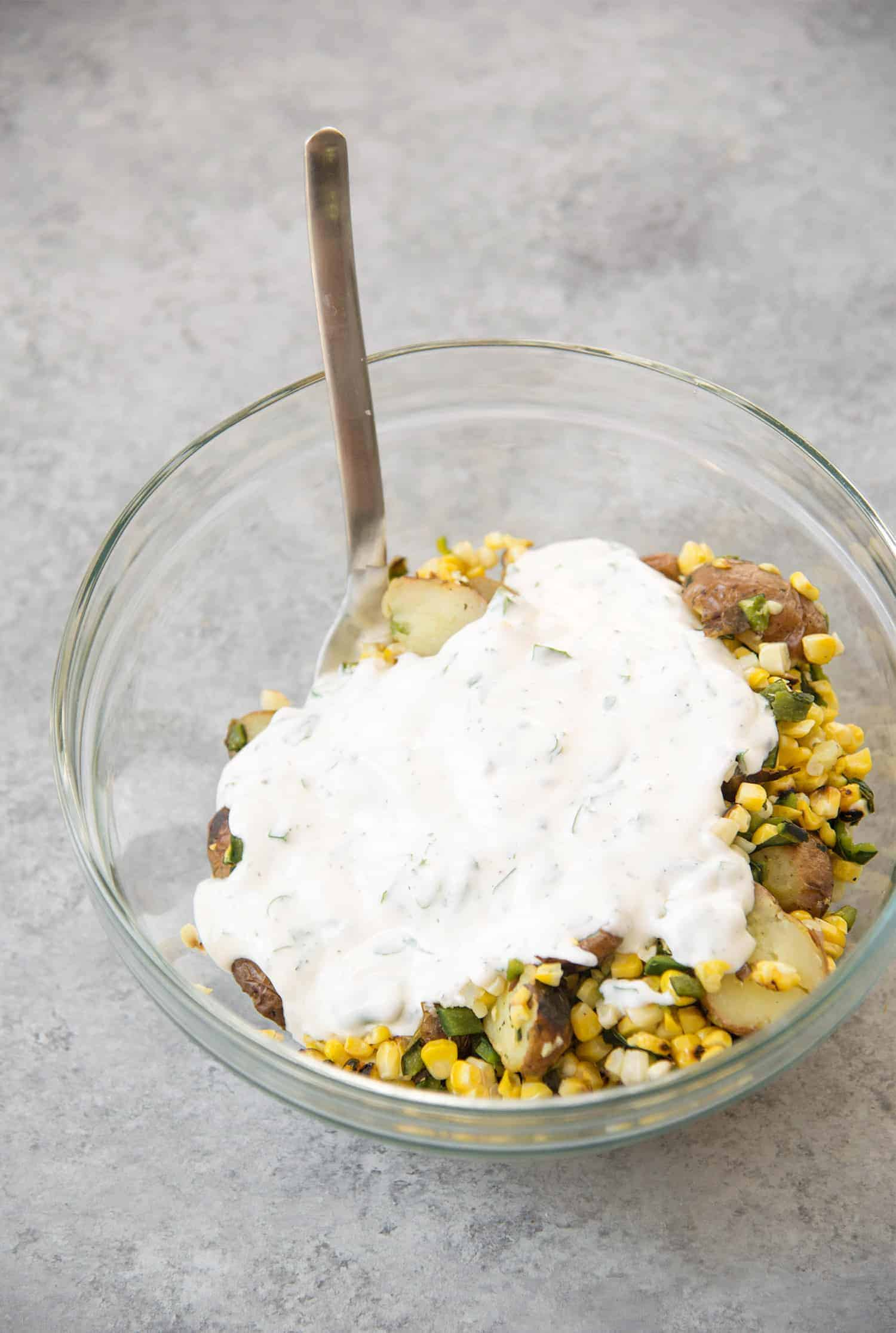 Grilled Corn, Poblano and Potato Salad! A must-make for summer BBQs and potlucks. Grilled corn, potato and poblano peppers mixed with a dairy-free basil dressing. Vegan and Gluten-Free   www.delishknowledge.com