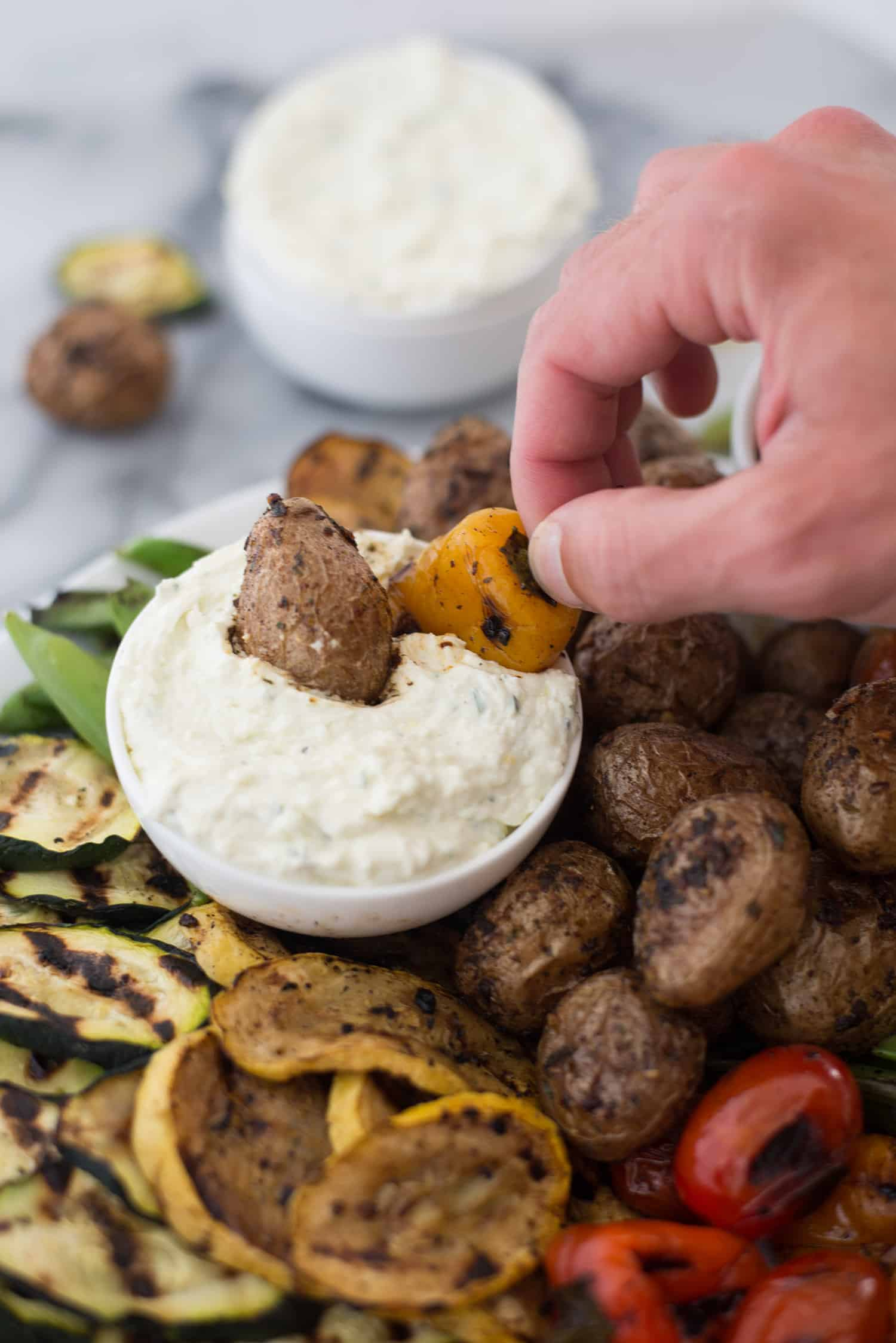 Grilled Vegetable Platter with Lemon-Feta Dip and Roasted Pepper Hummus! Easy, summer entertaining! Make a giant platter of grilled vegetables and dip ahead of time for no-fuss dinner. BBQ grilled potatoes, any vegetable you want and a salty, tangy dip! Vegetarian and gluten-free. | www.delishknowledge.com