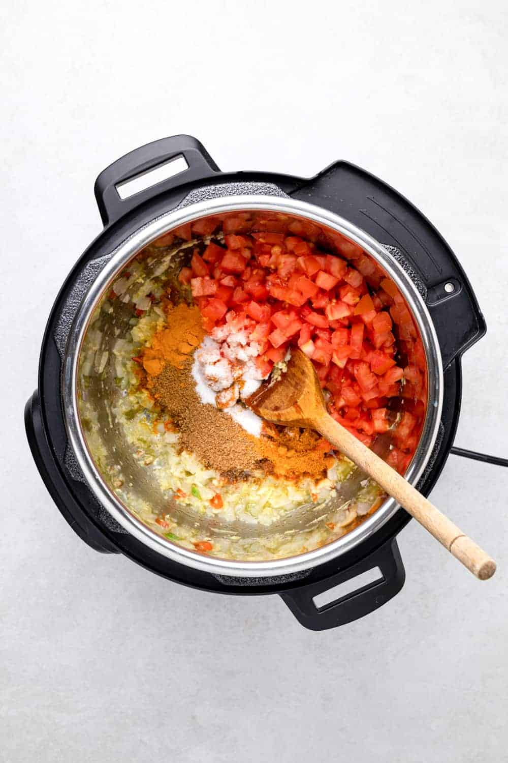 tomatoes and spices in the instant pot