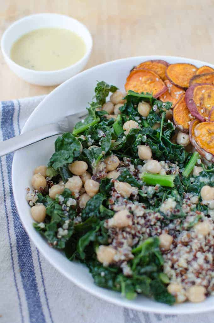 Get your veggies on! Such a healthy meal with 16g of protein! #Gluten-free and #Vegan! A vibrant-nutrient packed bowl of kale, chickpeas, sweet potatoes and quinoa. Tossed with a creamy miso-caesar dressing.