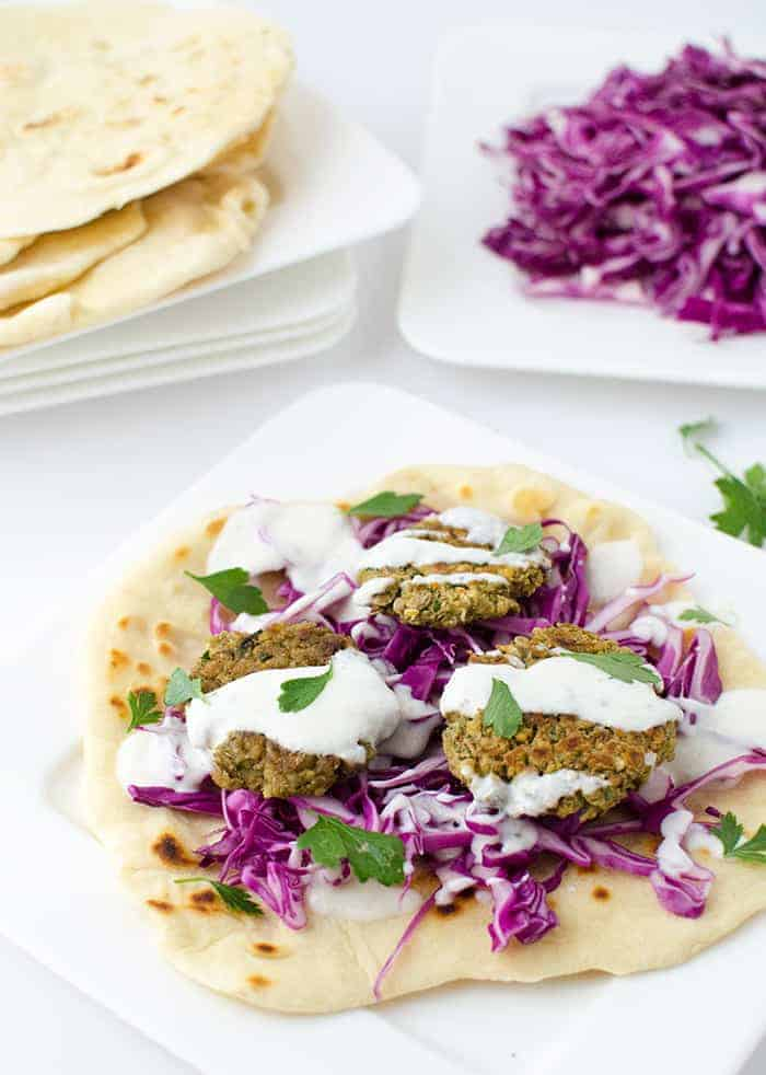 Lentil flatbread sandwiches! Homemade flatbreads with lentil fritters, cabbage, and healthy yogurt sauce. Vegetarian with vegan option