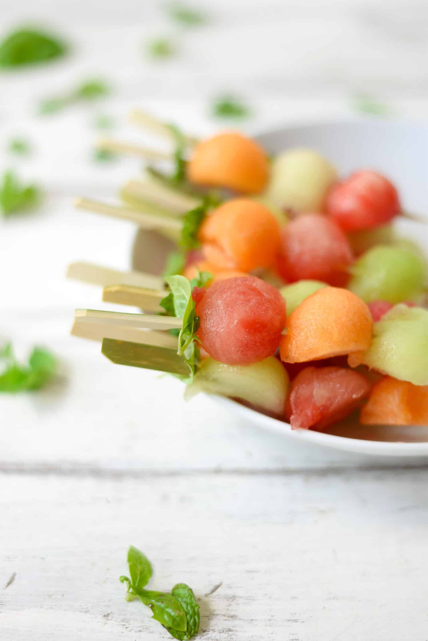 Melon Ball Skewers with Basil-Mint Dressing. A refreshing snack or dessert for summer! Vegan and Gluten-Free | www.delishknowledge.com