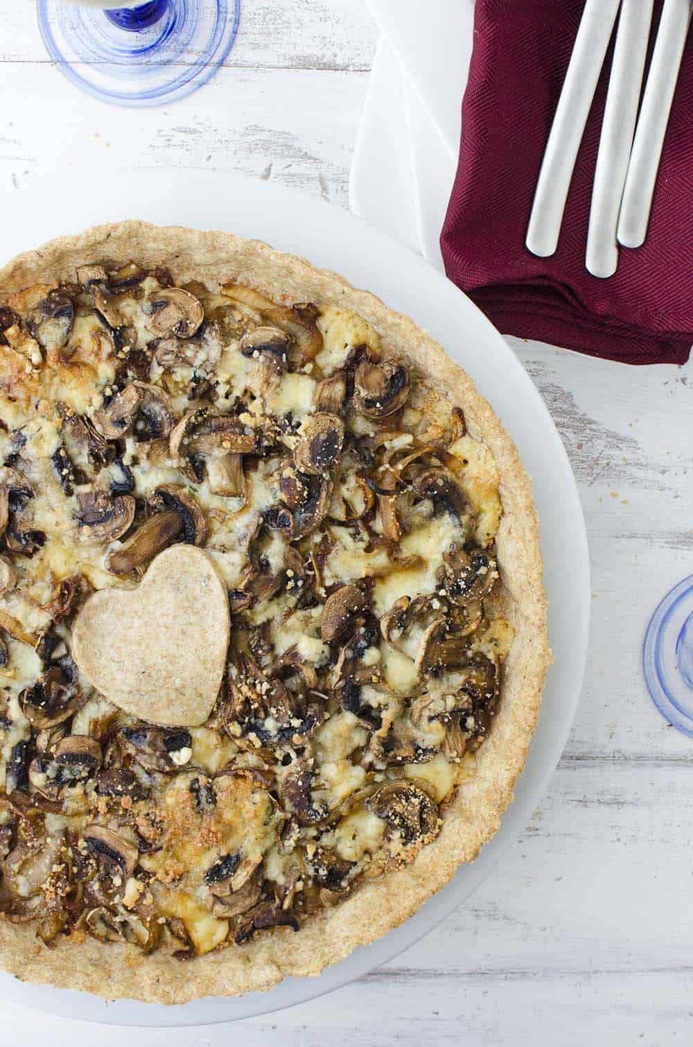 Caramelized onion and mushroom tart! The perfect vegetarian appetizer, side or main dish. Whole wheat tart stuffed with onions, mushrooms, and gorgonzola cheese.   www.delishknowledge.com
