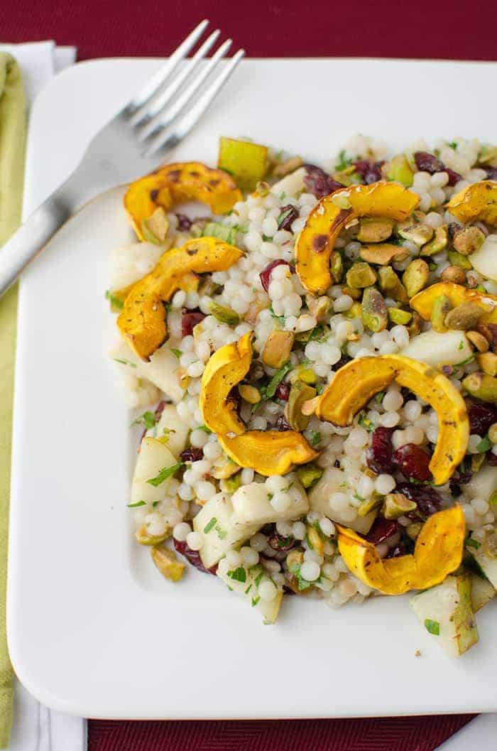 Fall Salad! Healthy, vegan. Israeli couscous tossed with roasted delicata squash, cranberries, pistachios, and pear. Maple Apple Dressing! | www.delishknowledge.com