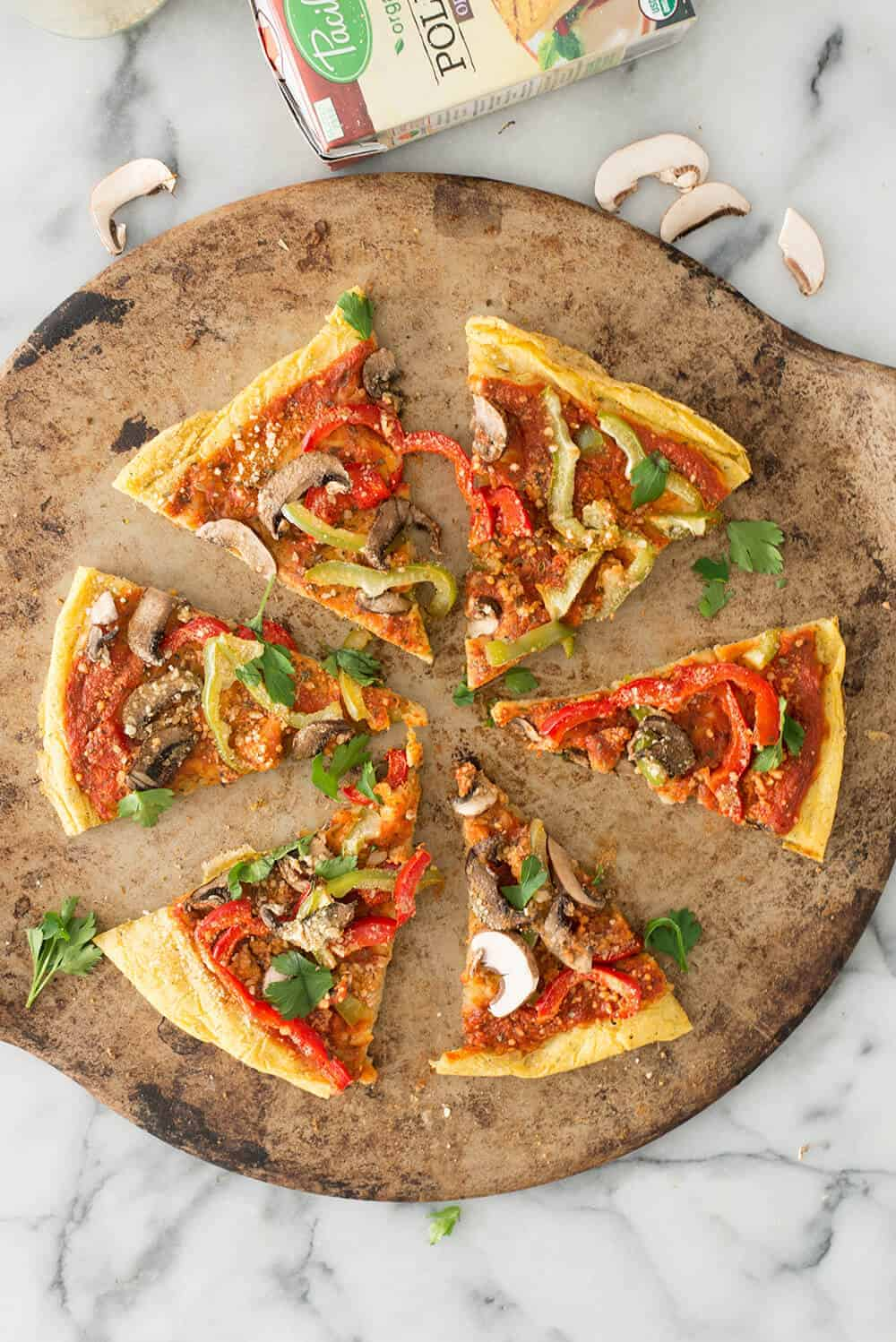 Polenta Pizza! Healthy, gluten-free take on pizza. Creamy polenta crust topped with sauce, veggies and vegan parmesan cheese. A must-make. | www.delishknowledge.com