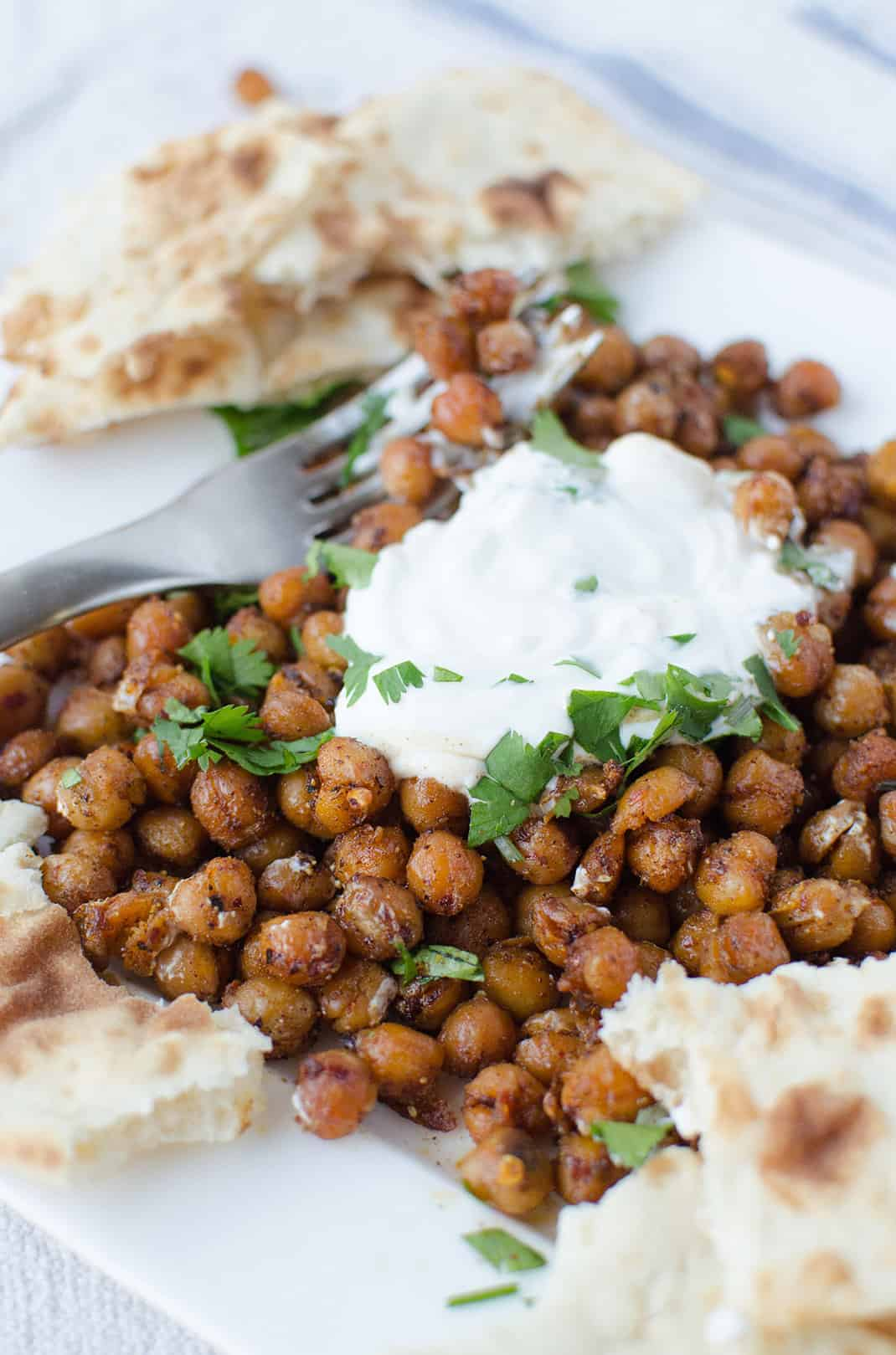 Dinner is ready in just 15 minutes! Roasted Indian chickpeas with tamarind sauce, yogurt and cilantro. Healthy, high protein and easy!   www.delishknowledge.com