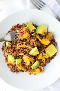 Who says lentils are boring!? Not these! A twist on traditional lentil salad! French lentils cooked in orange juice then topped with oranges, shallots and creamy avocado. #vegan and #lglutenfree | www.delishknowledge.com