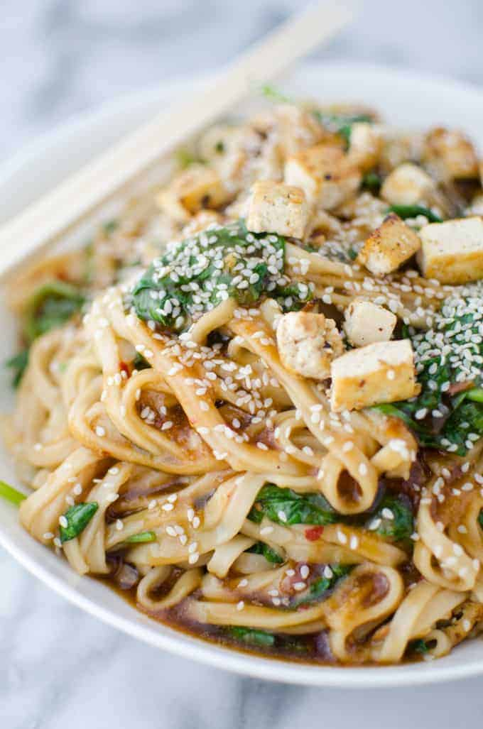 Fresh ginger-sesame sauce stir-fried with udon noodles, quick fried tofu and spinach! So much healthier than take-out! | delishknowledge.com