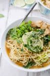 Spicy Asian Noodle Bowl! Spaghetti in a spicy asian broth topped with tofu and vegetables. Vegan comfort food! | www.delishknowledge.com