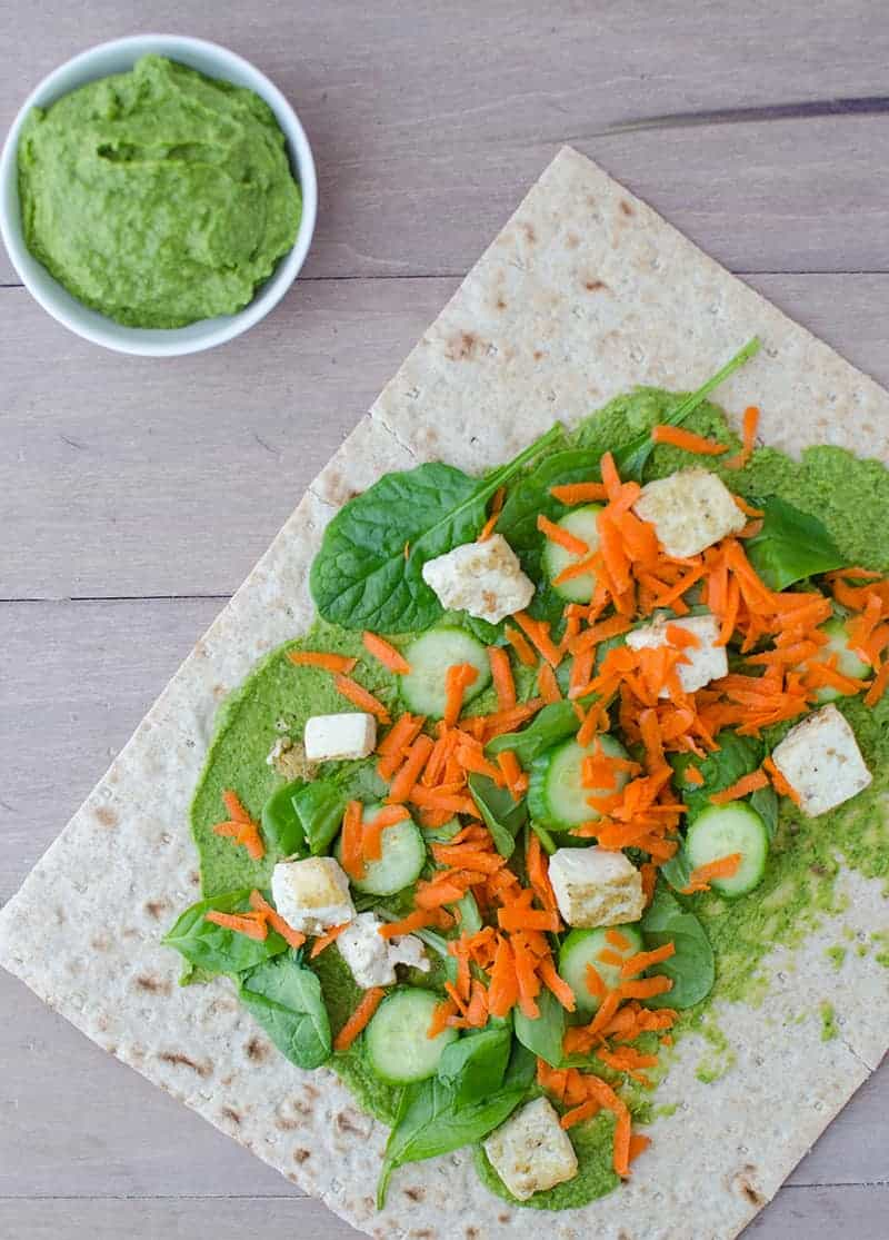 Spinach Hummus! Slightly spicy hummus wrapped into whole wheat lavish bread and topped with veggies and lightly fried tofu. Healthy and filling lunch!