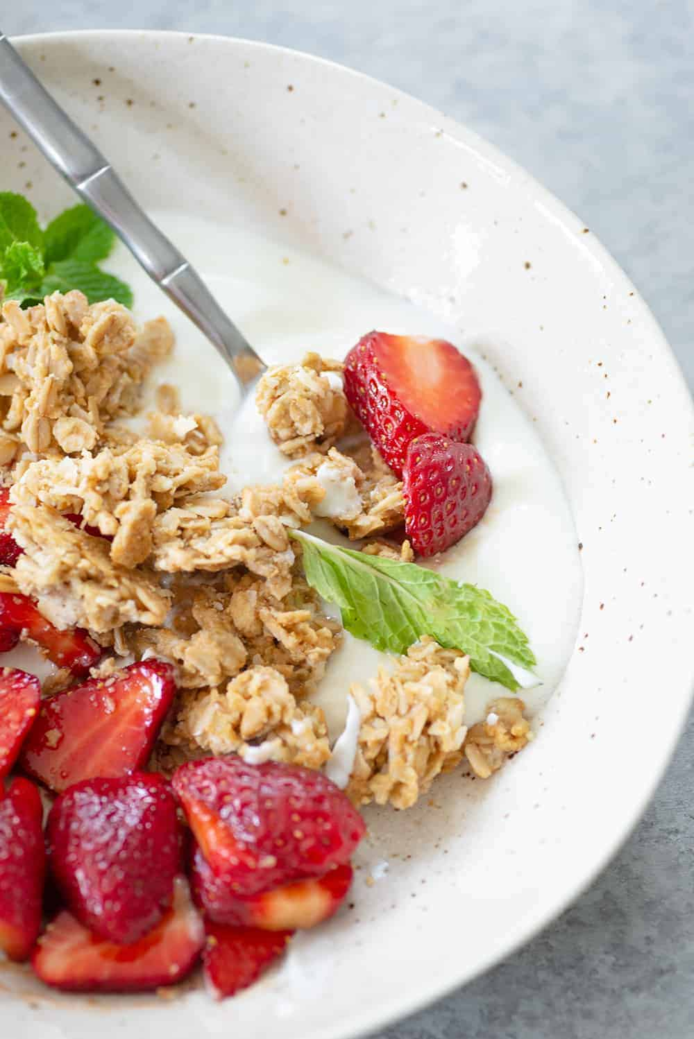strawberry yogurt bowl with coconut granola
