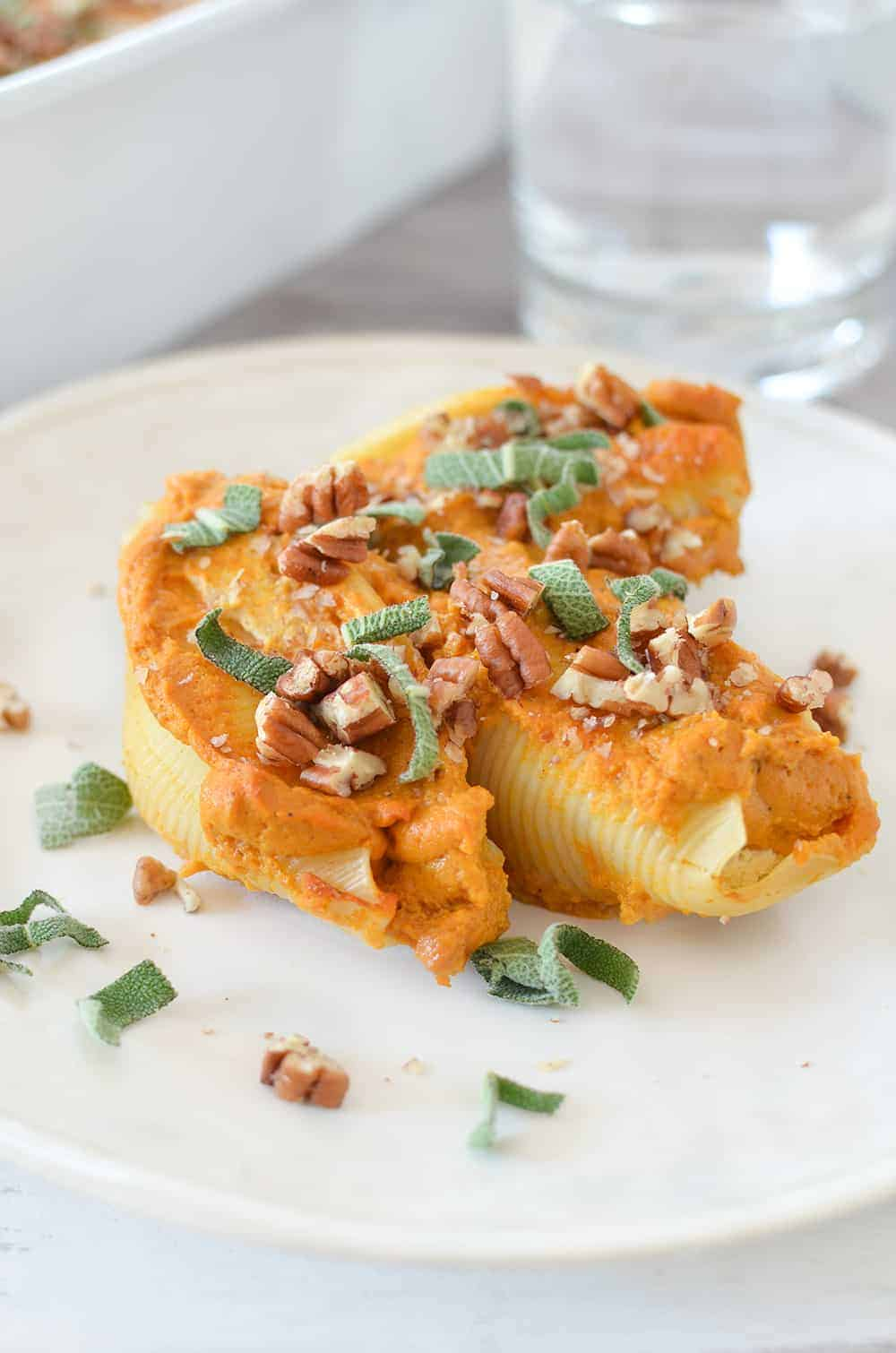 Vegan Stuffed Shells with Pumpkin Cream Sauce! Tofu ricotta stuffed into jumbo shells and baked in a creamy pumpkin sauce. Showstopper dinner for the holidays! | www.delishknowledge.com