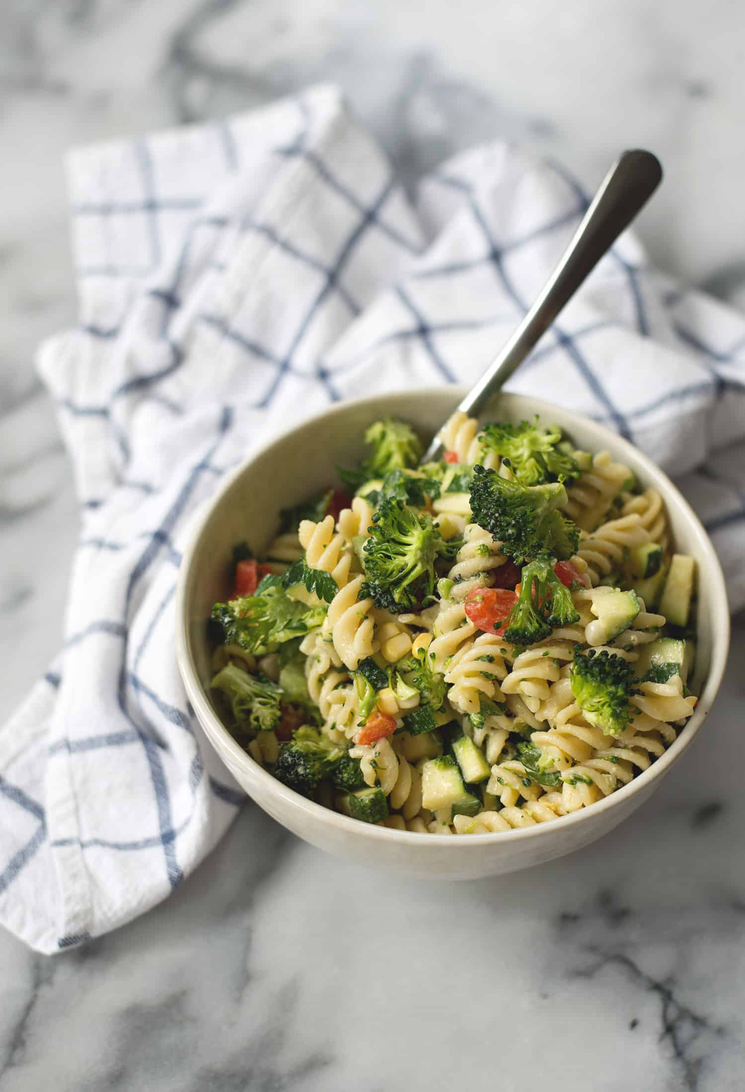 Summer Pasta Salad with Lemon-Tahini dressing! If you like Goddess salad dressing, you will love this salad! Noodles, four vegetables, tahini dressing, parsley and basil. Vegan | www.delishknowledge.com