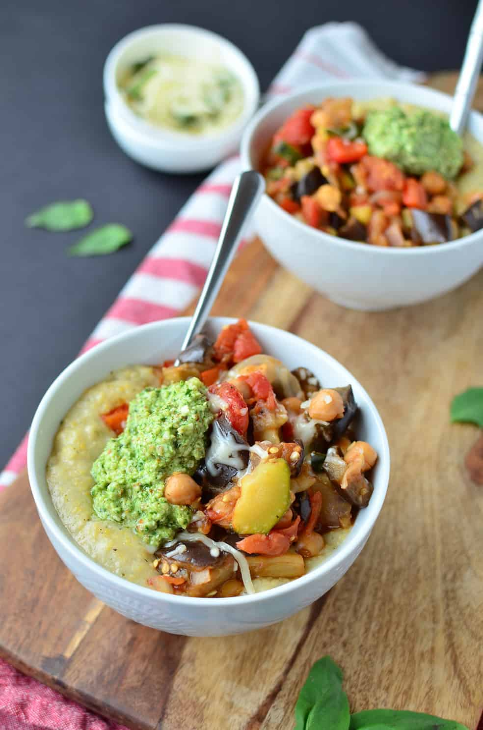 Summer Vegetable Polenta Bowls! Creamy garlic & herb polenta topped with roasted summer vegetables and pesto. Hearty and healthy! #vegetarian #glutenfree | www.delishknowledge.com