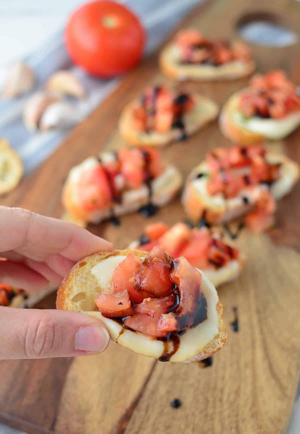 The BEST tomato bruschetta- thanks to a secret ingredient! One of the most popular and most-pinned recipes on my blog. You have to make this one!