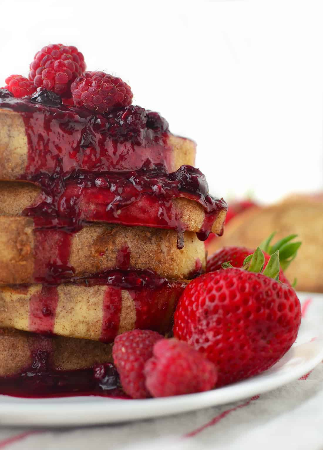 Triple Berry Syrup! The perfect topping for french toast, pancakes, ice cream and more! Low-sugar and packed with antioxidants. #vegan #vegetarian | www.delishknowledge.com