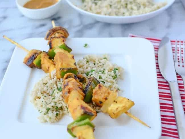 Grilled veggie kebobs with pineapple, mushrooms, peppers and tempeh! Slathered in a sweet and spicy pineapple-serrano sauce! Served with cilantro rice.