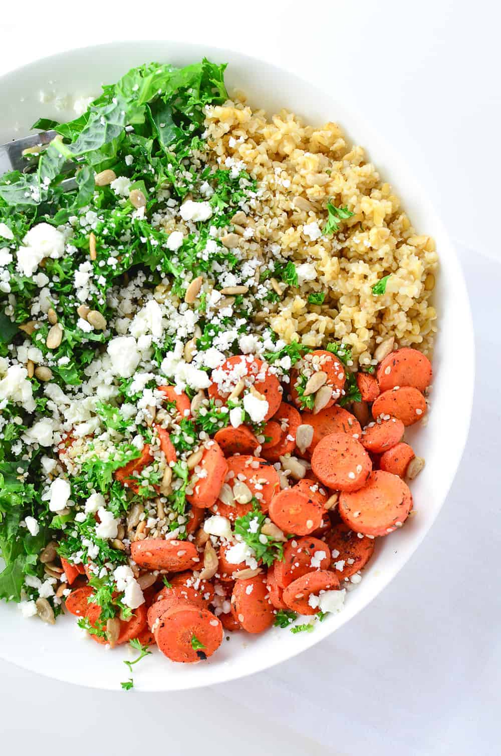 The Ultimate Goddess Bowl! Freekah, kale, roasted carrots, and a creamy goddess dressing! This healthy grain bowl is so easy and packed with flavor! | www.delishknowledge.com
