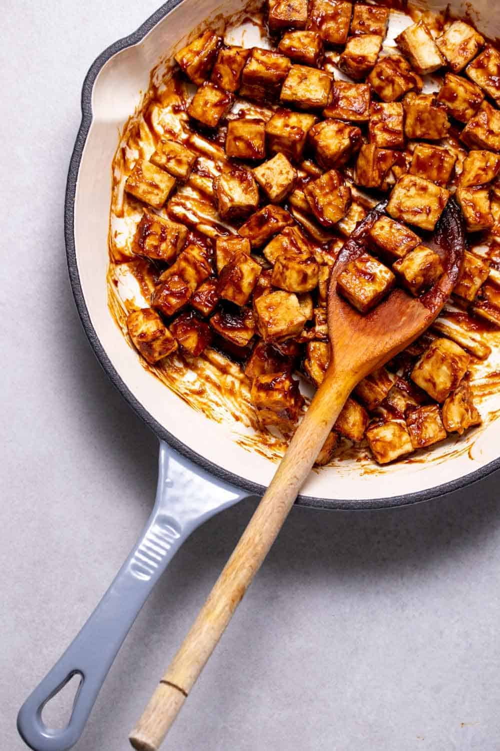 Hoisin glazed tofu in a cast iron pan