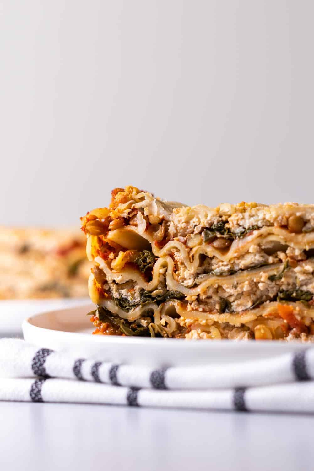 Close up shot of the spinach lasagna with cashew riccota