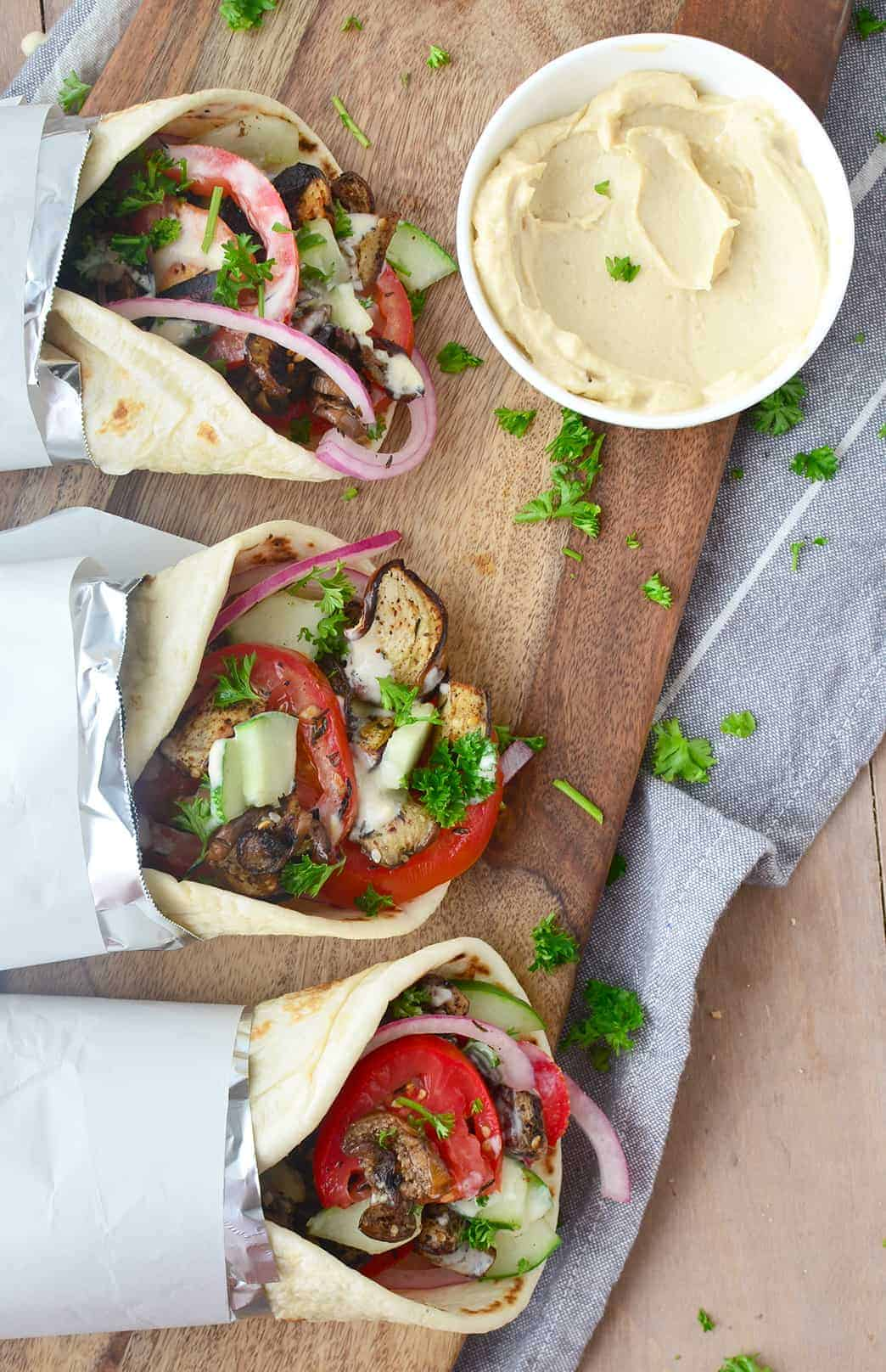 Meaty vegan eggplant gyros stuffed with vegetables, herbs and the best hummus sauce. So good! #vegan #vegetarian | www.delishknowledge.com