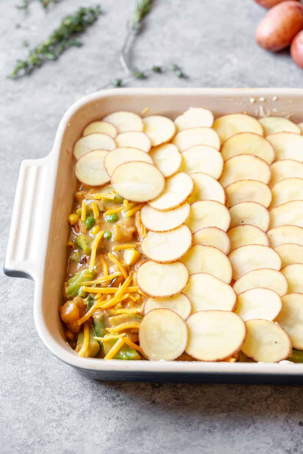 vegetable pot pie with scalloped potato crust