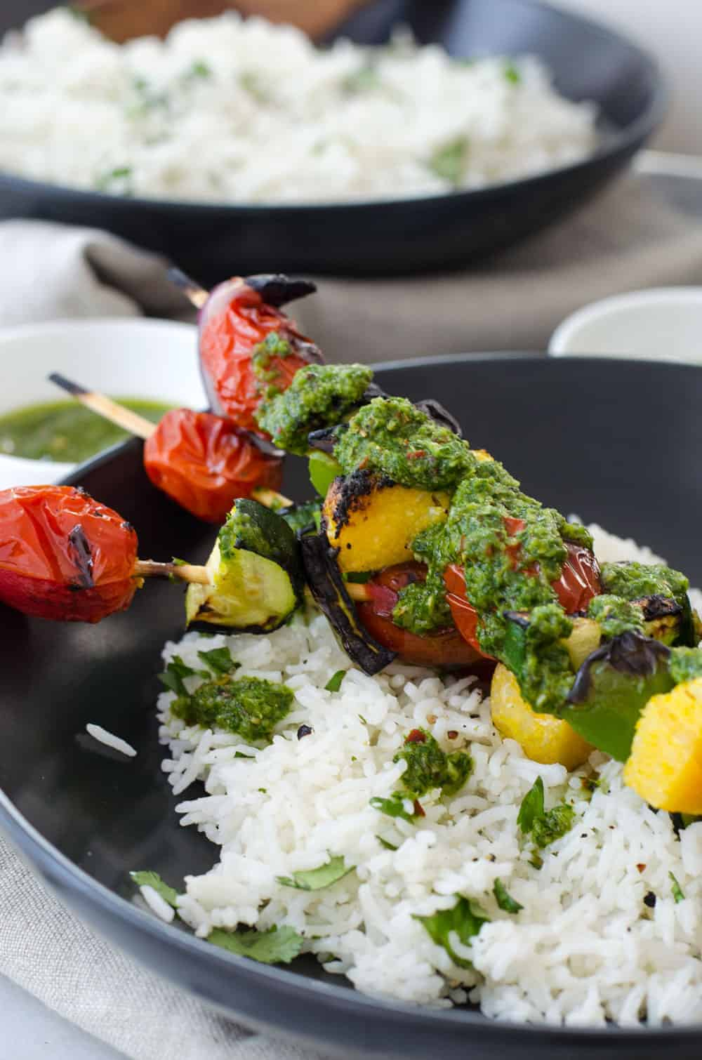 Vegan Polenta Kebobs with Chimichurri Sauce! Perfect for cookouts this summer! Served with herbed rice, this vegan and glutenfree dish is a must make. | delishknowledge.com