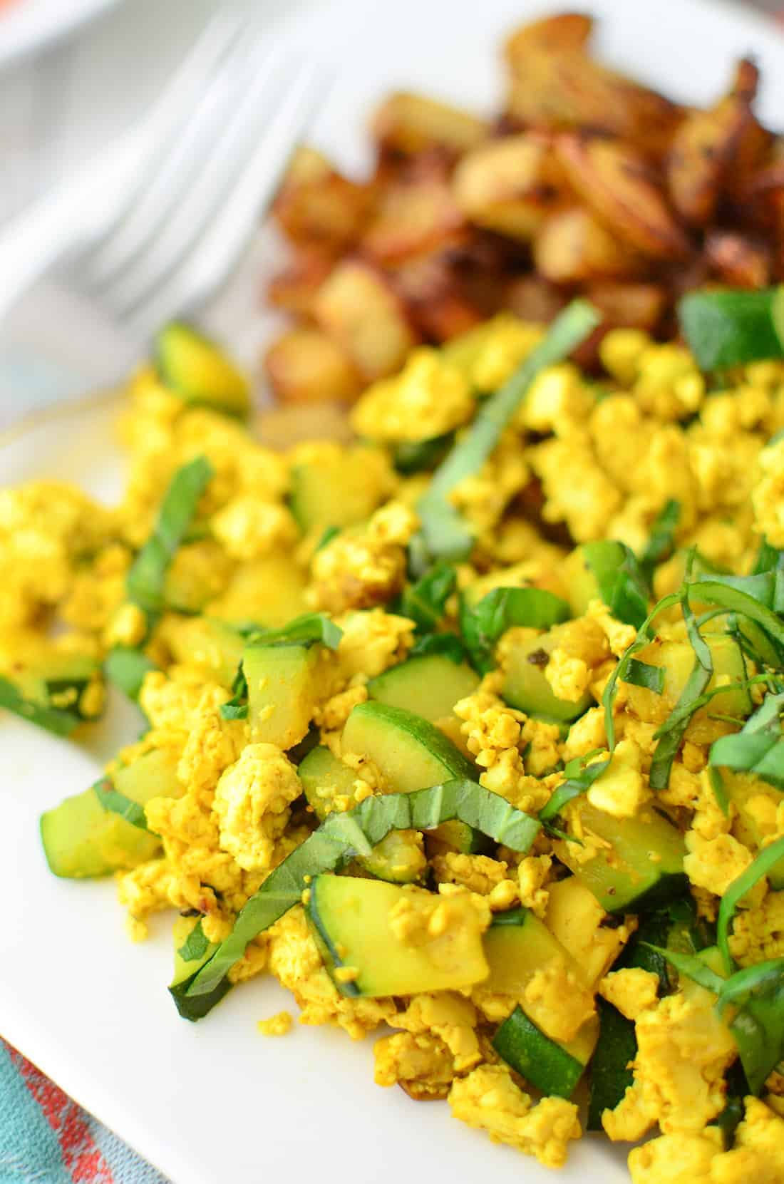 Zucchini and Basil Scramble! A healthy, cholesterol free breakfast option. If you haven't tried tofu scramble before, you're in for a treat! High protein and taste just a lot like eggs! | www.delishknowledge.com